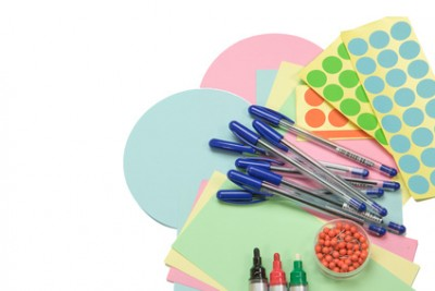 Moderator accessories are spreading out on an isolated white background. (Colorful circular and rectangular paper, pens, pins and colorful stick-on labels)