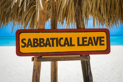 Sabbatical Leave sign with beach background
