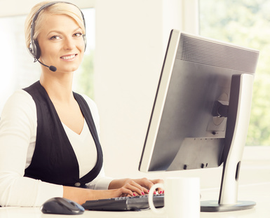 Support operator at work in a call center. Attractive female office worker. Business concept.